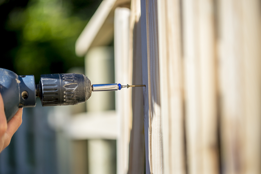 drilling the white fence
