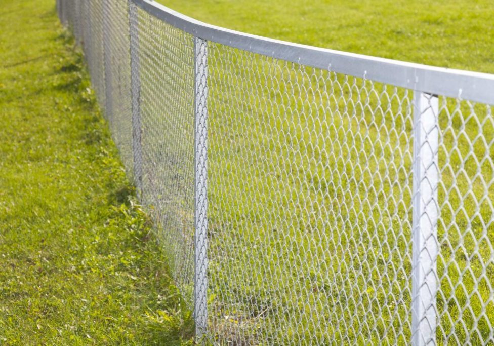 chain link fence in the field